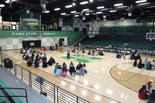 Students gather in groups at Maj. Ron Milam Gymnasium during the